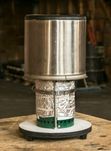 Wood gas stove with insulated pot. Foil provides additional insulation for the combustion chamber.